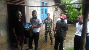 Yonif-7 Marinir Bantu Warga Desa Gayau
